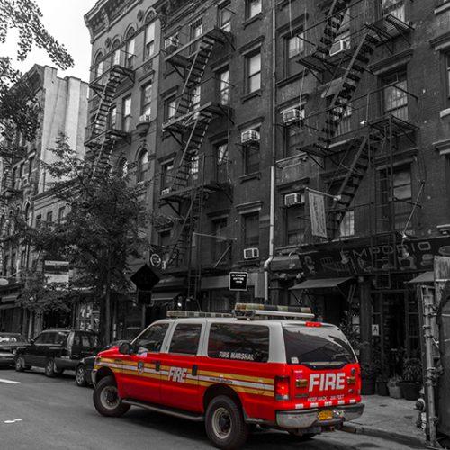 Streetview of a New York city fire marshal's truck, on Mott street